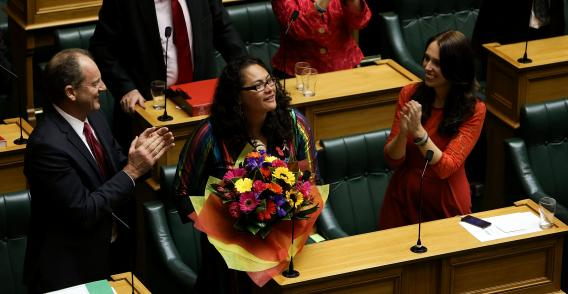 One of the NZ  MP's who co-sponsored the marriage equality bill is congratulated after its approval.